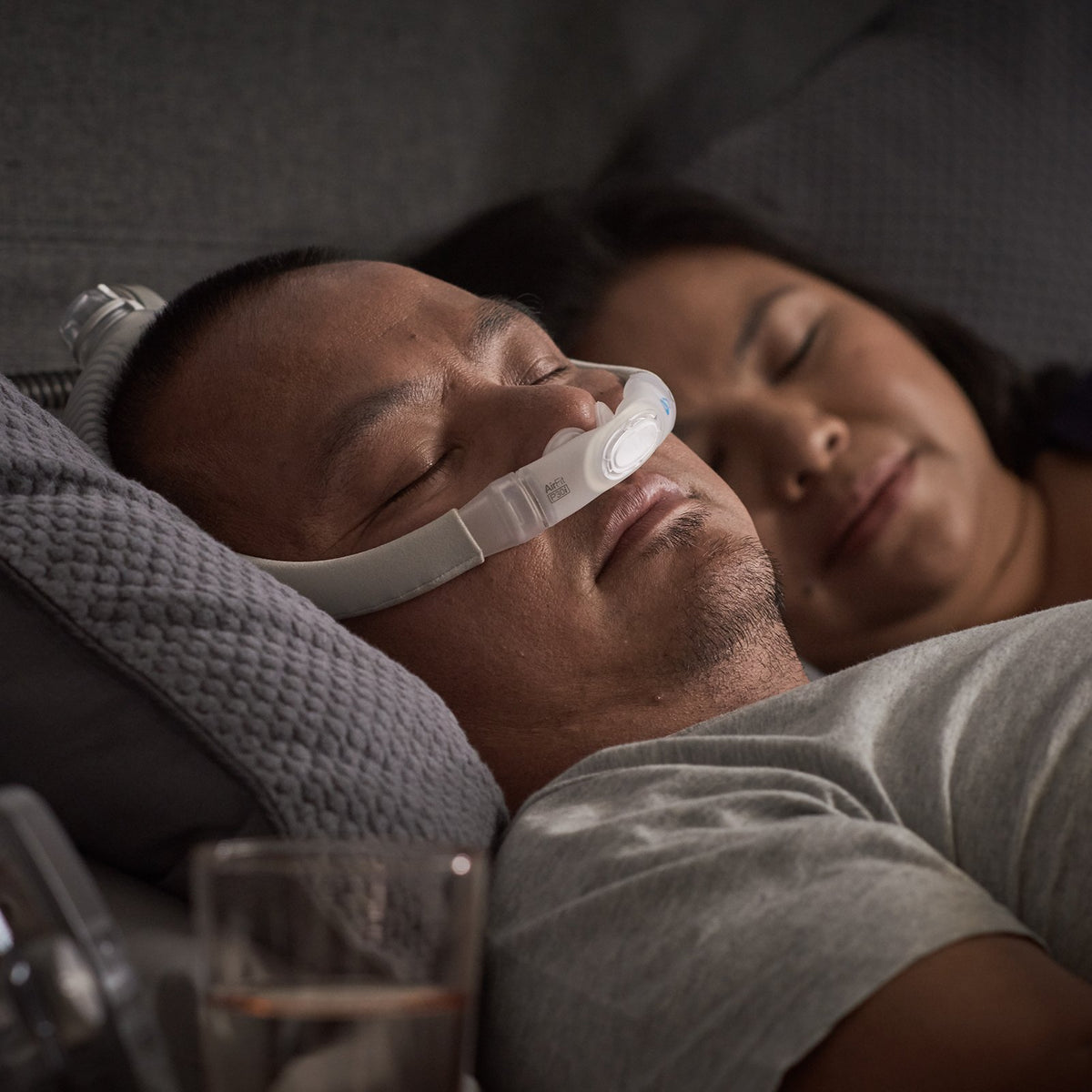 Man Sleeping with ResMed AirFit P30i Frame System.