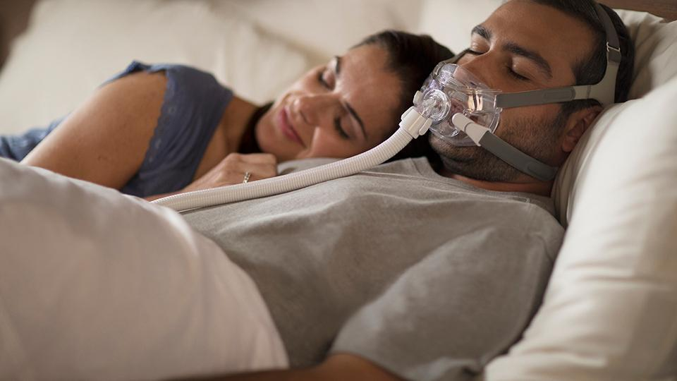 Couple sleeping with Amara mask
