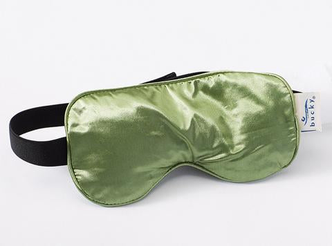 Side view of Serenity Spa Mask in sage color with black strap.