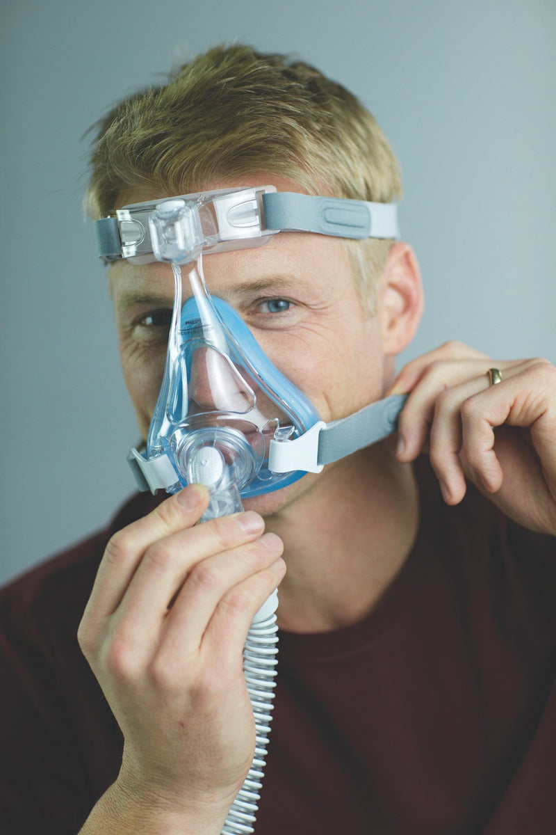 Man adjusting low straps of Amara Full Face CPAP Mask with Gel & Silicone Cushions