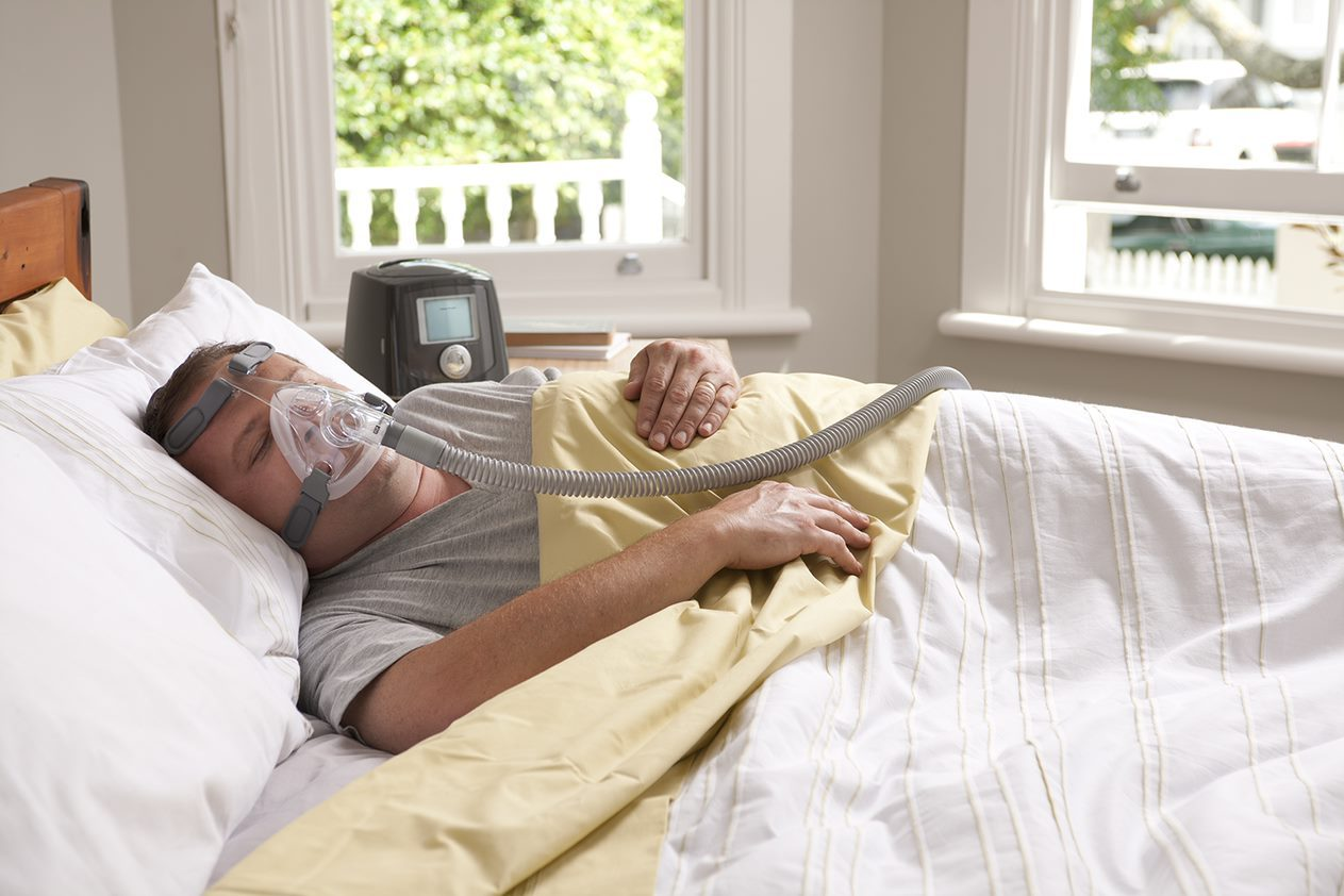 Here is a picture of a man slepeing with the Simplus Full Face Mask for Fisher & Paykel