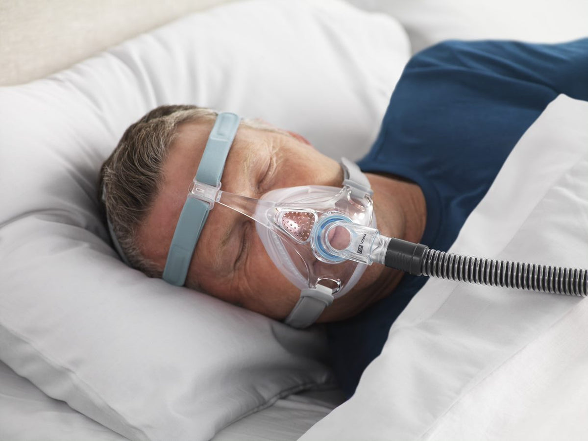 Man Sleeping With Vitera Mask.