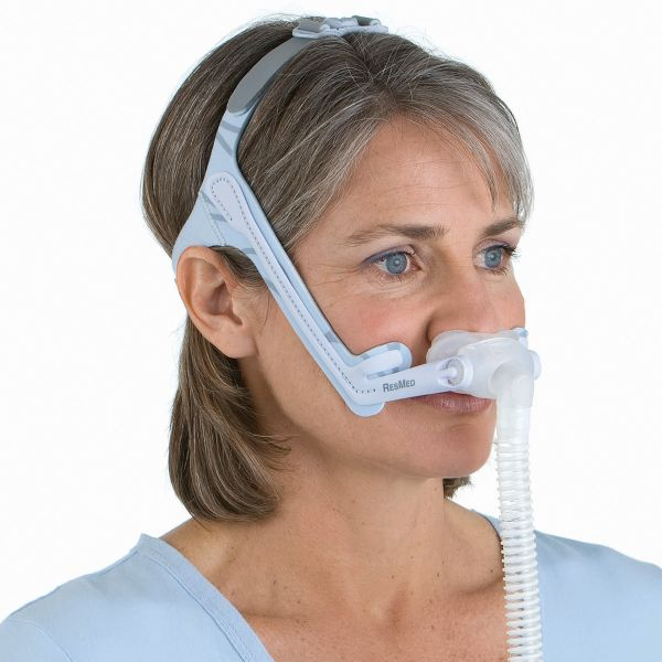 Woman wearing ResMed Swift LT for Her Nasal Pillow Mask