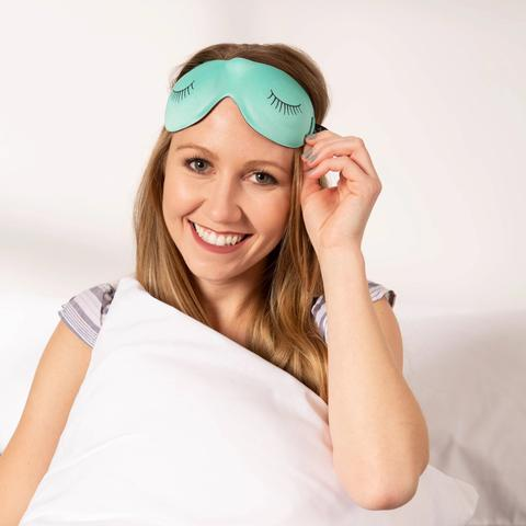 Woman sitting with the Ultralight Sleep Mask Aqua Eyelashes Style by Bucky in her head.