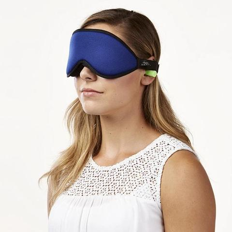 Woman using the green earplugs with the Blockout Shade Mask in blue color.