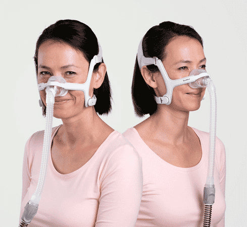 Women using ResMed Air Touch N20 Nasal Mask For Her with grey and lavender part color on headgear.
