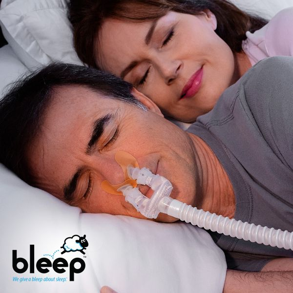 Couple sleeping with Bleep Dreamport