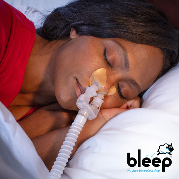 Woman sleeping with Bleep Dreamport.