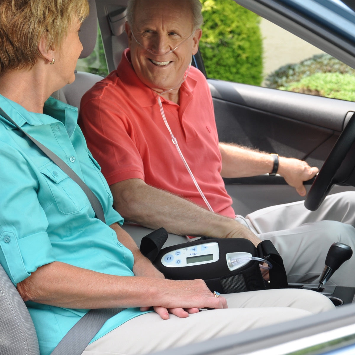 Man Driving With Inogen One G3 Portable Oxygen Concentrator.