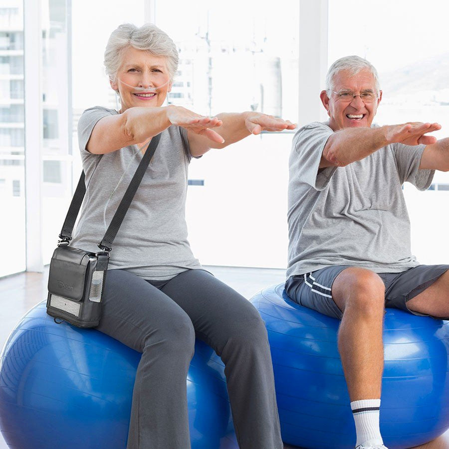 Couple Working Out Together With Inogen One G5 Portable Oxygen Concentrator Bundle.
