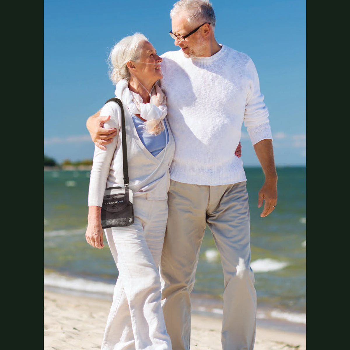 Couple On Beach Using Inogen One G5 Portable Oxygen Concentrator Bundle