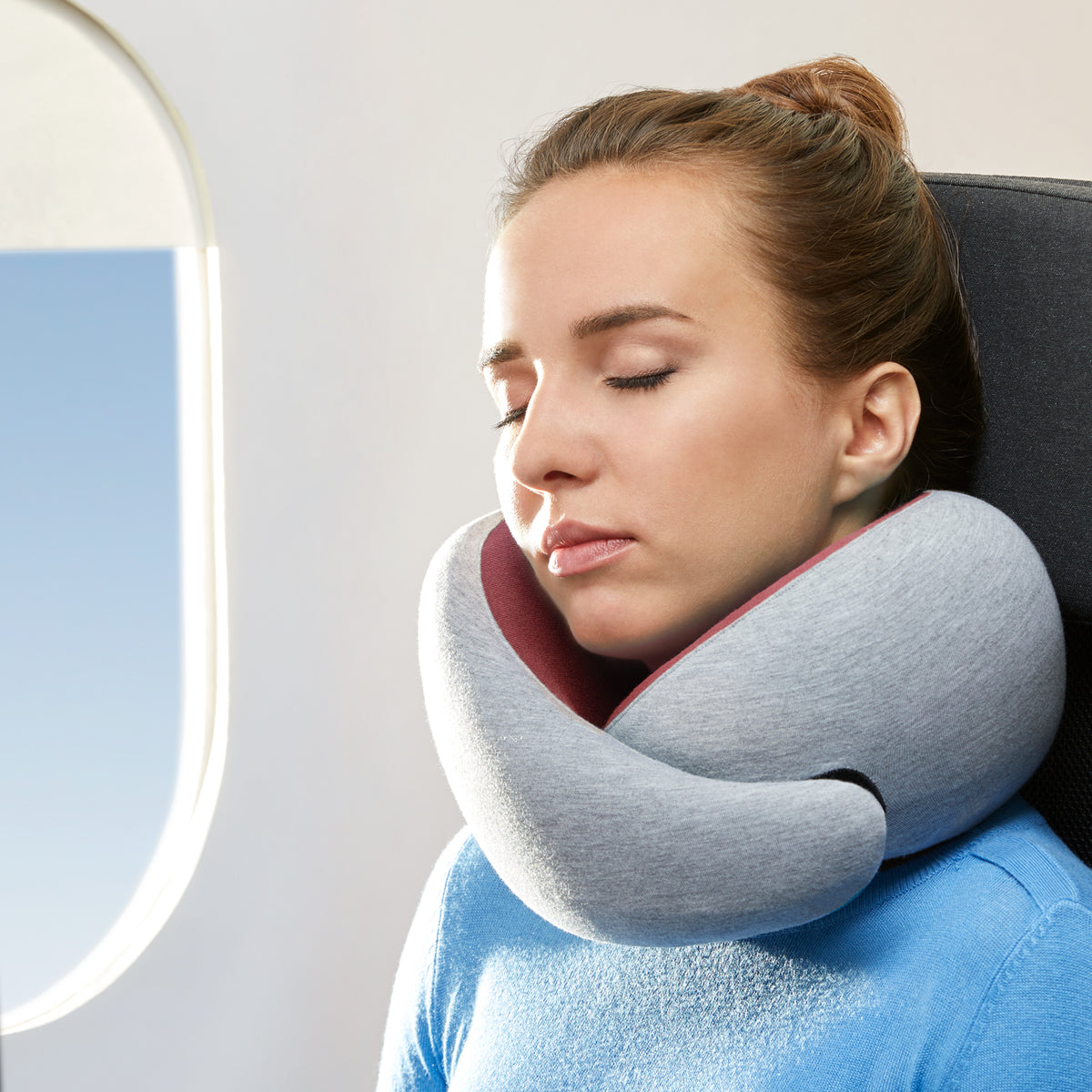 Woman Sleeping On Plane With Dreamtastic Neck Pillow.