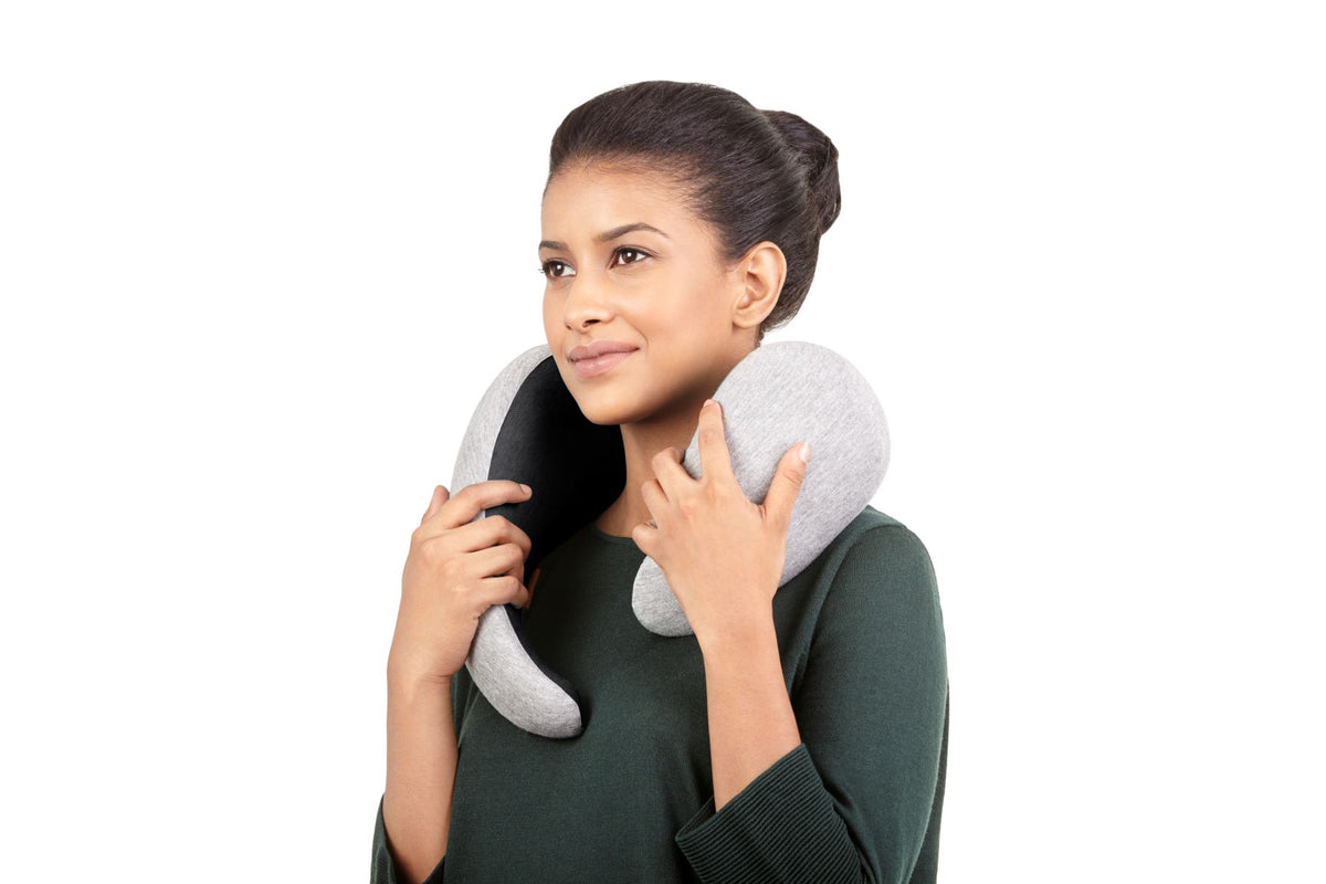 Woman Trying On Neck Pillow.