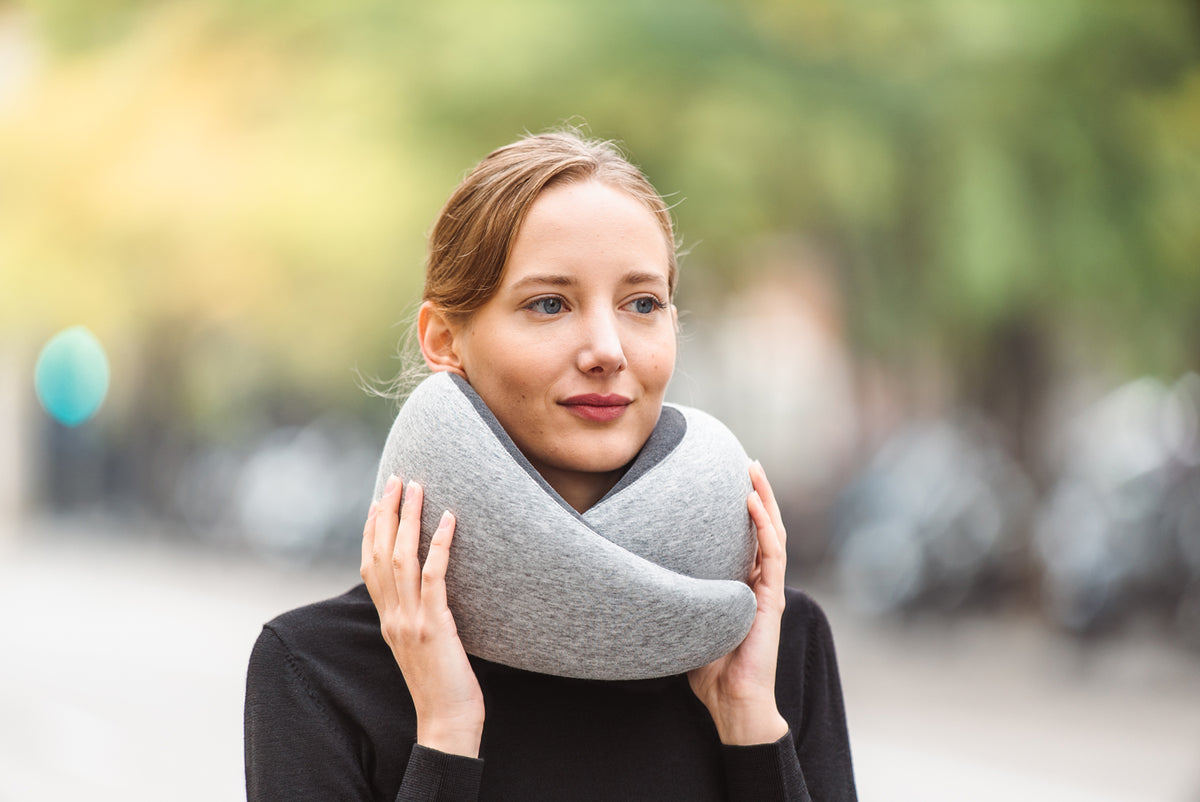 Woman On Street Wearing Midnight Grey Neck Pillow.