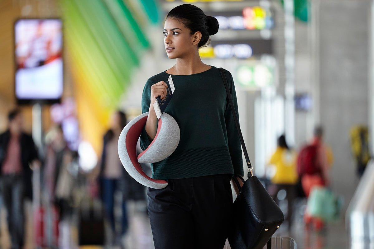 Woman Walking With Dreamtastic Neck Pillow.