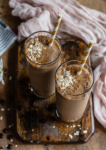 Two tall glasses of Vanilla Cinnamon Coffee Smoothie from this easy morning recipe featuring Peet's new Vanilla Cinnamon Flavored K-Cups.