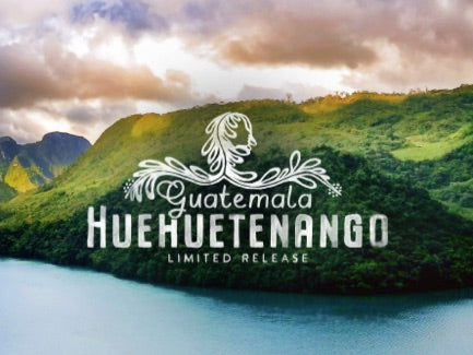 A photograph of the landscape where Peet's Guatemala Huehuetenango coffee is grown, overlaid with a graphic lock up of the name of the limited release coffee.