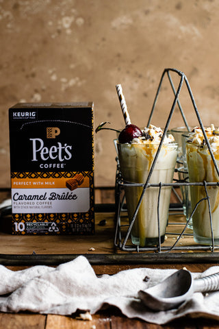 A box of Peet's Caramel Brulee Flavored K-Cup Pods and a tray of Caramel Brulee Coffee Milkshakes