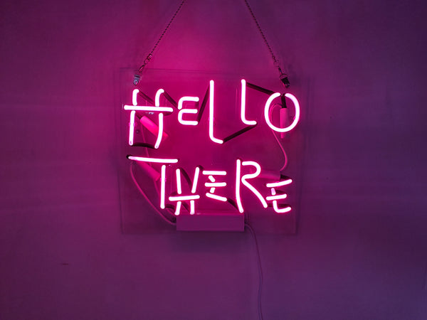 hello there pink neon sign example of real neon vs led light