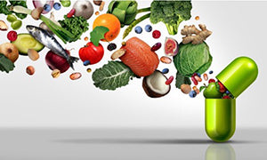 Antioxidants and healthy food coming out from the inside of a supplement capsule.