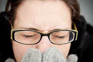woman sneezing from cold or flu