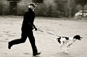 man and dog running for exercise