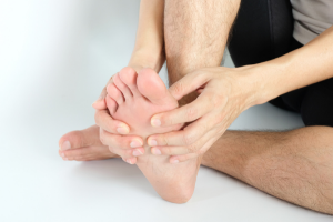 Man with gout massaging sore toe