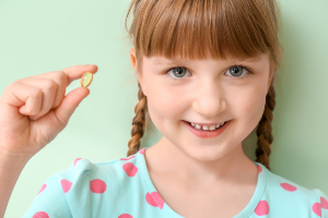 girl getting ready to take a nutritional supplement