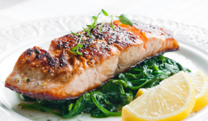 salmon and greens can help boost your mood