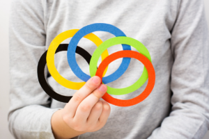 person holding Olympic rings