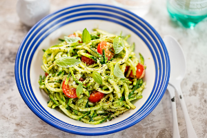 zucchini noodles with pesto and cherry tomatoes