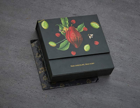Vanilla- Blue beauties filled with white chocolate ganache and the delicate scent of vanilla