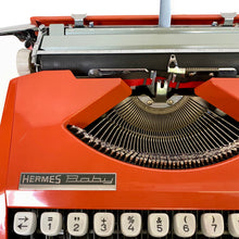 Load image into Gallery viewer, Baby Hermes Orange Vintage Typewriter - ShopCurious