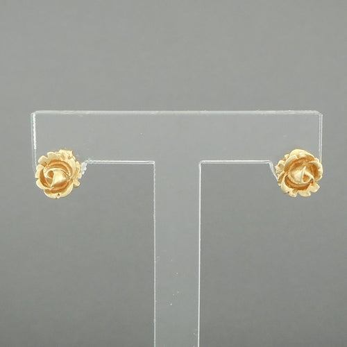 Vintage 14K Rose Stud Earrings. Dainty post earrings, sculptured flower design for pierced ears. Each is marked 14k, as well as the backings.  Each approximately 5/16