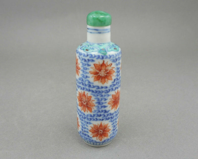 An Antique Qing Dynasty Chinese Porcelain Snuff Bottle, cylinder form with polychrome decoration, green, blue and iron red. Floral design. It is one of a collection recently acquired from a Philadelphia estate.  somewhat irregular due to what appears to be repairs. FREE US Shipping