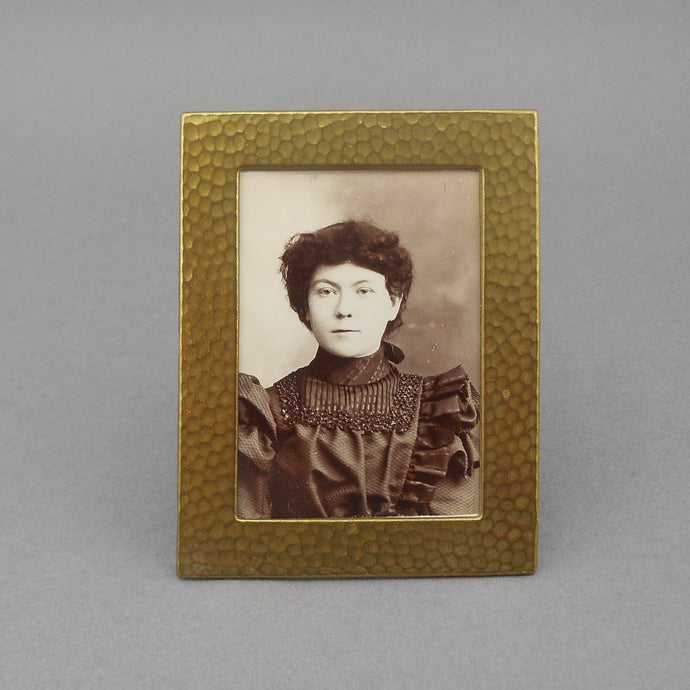 Antique Arts and Crafts Miniature Picture Frame, easel / table top design with a Victorian era portrait photograph. Gilded steel or tin with a hammered texture.   Approx. 2 1/8