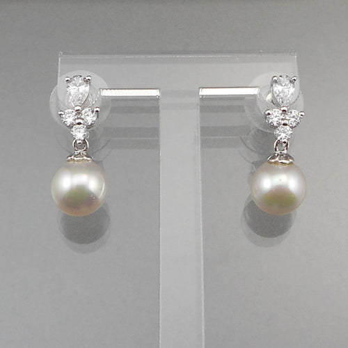 A circa 1980 dangle earrings. 14k white gold posts for pierced ears. Crystals or CZs set in sterling silver with round faux pearl drops. Perfect for a bride. Excellent vintage pre-owned condition - barely, if ever, used. There is a minor scratch on each pearl, but on the reverse. FREE US Shipping via USPS standard
