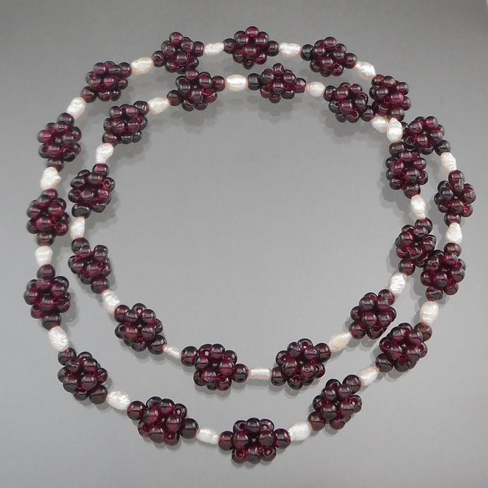 Vintage Handcrafted Garnet Bead Necklace. Maker unknown. Clusters of garnet beads strung with natural pearls.  Approximately 1/2