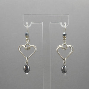 "A circa 1990 pair of heart design dangle earrings with hematite beads. Pewter tone finish with wires for pierced ears.  Each approximately 5/8"" X 1 7/8"" which includes the wires.  Excellent vintage pre-owned condition.  FREE Shipping via USPS standard shipping to Continental US locations"