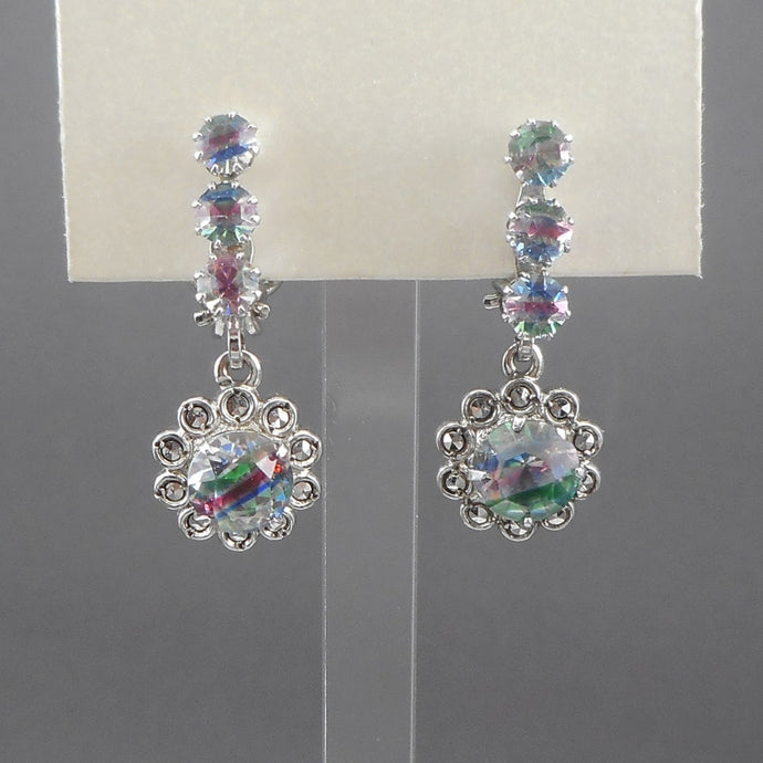 Vintage flower design dangle earrings, iris crystals and marcasite in silver settings. One is marked 835, the other 800. Clip on for non pierced ears.  Each approximately 1/2