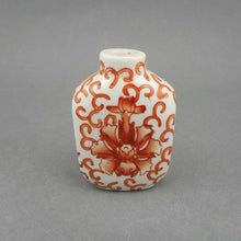 "Load image into Gallery viewer, An Antique Chinese Porcelain Snuff Bottle, Qing Dynasty, 19th century, decorated with iron red flowers. It is one of a collection recently acquired from a Philadelphia estate.   Approximately 1 5/8"" x 1"" x 2 3/8"" h.   Excellent antique condition with minor glaze crazing and finish loss, free of cracks and chips. The crazing is difficult to see without magnification. The bottle is being presented as found, no cleaning or restoration has been done."