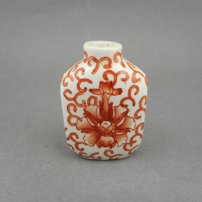 An Antique Chinese Porcelain Snuff Bottle, Qing Dynasty, 19th century, decorated with iron red flowers. It is one of a collection recently acquired from a Philadelphia estate.   Approximately 1 5/8