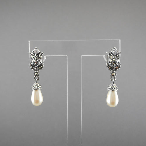 A circa 1990 pair of floral design dangle earrings by Judith Jack. Sterling Silver, marcasite, and crystal tulips with teardrop shaped faux pearls. Excellent vintage pre-owned condition - barely, if ever, used. There is a scratch on each pearl, but on the reverse FREE US Shipping via USPS standard shipping