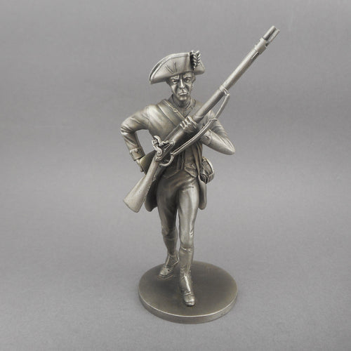 Vintage Revolutionary War soldier figurine.