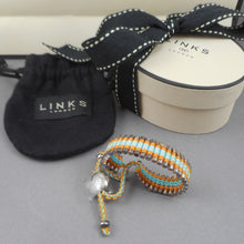 "Load image into Gallery viewer, Links London Ladies Friendship Bracelet in turquoise, yellow and silver - Unused with its original gift bag and box and storage pouch. Approximately 10"" (length is adjustable), just over 1/2"" wide Pre-owned, unused condition with original packaging. FREE Shipping via USPS standard shipping to Continental US locations"