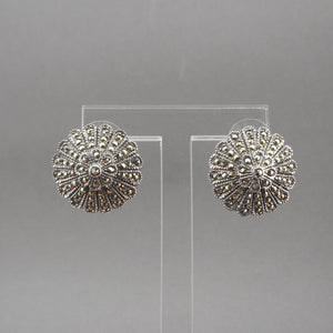 "A circa 1980 pair of flower design earrings. Posts for pierced ears of sterling silver with marcasite stones.  Each approximately 7/8"" diameter  Excellent vintage pre-owned condition with all stones in place. Minor surface scratches and tarnish. FREE US Shipping via USPS standard shipping"