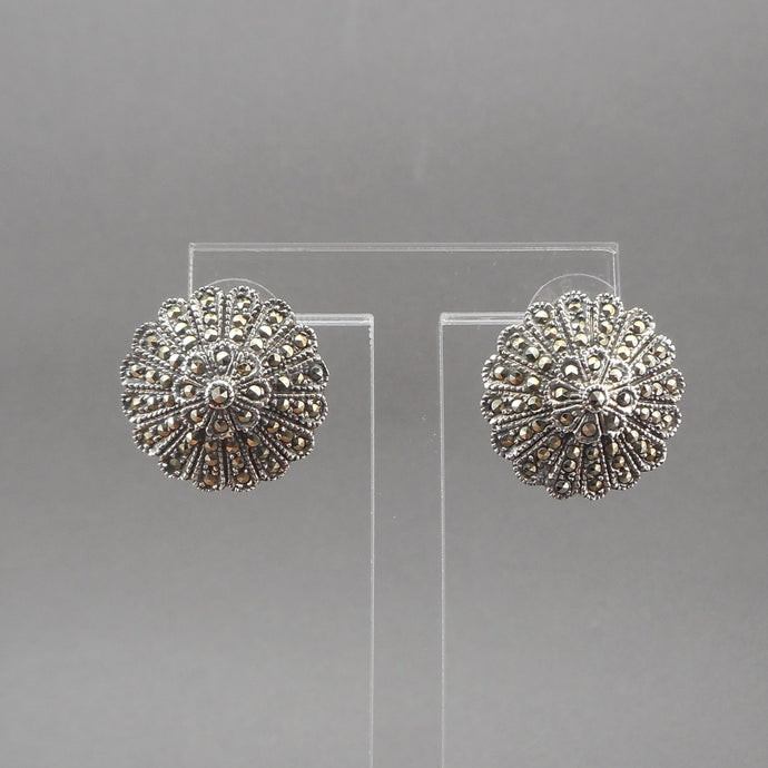 A circa 1980 pair of flower design earrings. Posts for pierced ears of sterling silver with marcasite stones.  Each approximately 7/8
