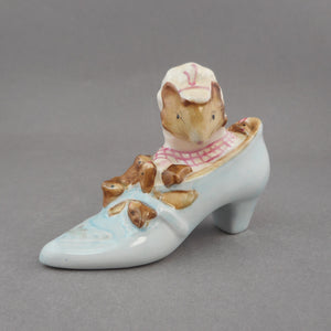 "Vintage ""The Old Woman Who Lived in a Shoe"" Beatrix Potter character figurine. Mama mouse and baby mice. Porcelain, dated 1959 by F.Warne & Co. Ltd., Beswick England.  Approximately 1 1/4"" x 3 1/2"" x 2 5/8"" h.  Excellent vintage pre-owned condition, free of crazing, cracks, nicks or chips. FREE US Shipping"
