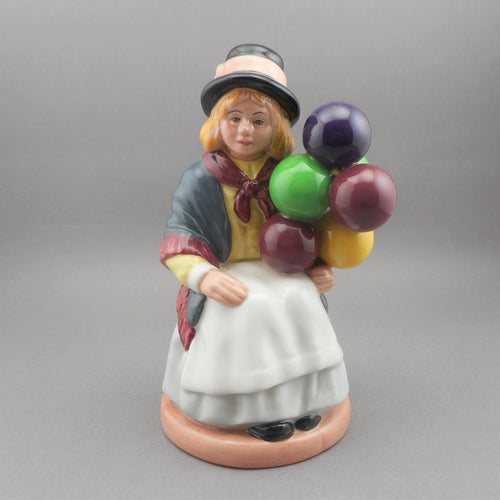 Vintage Royal Doulton porcelain collector figurine.