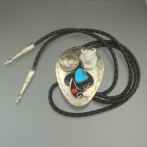 Vintage Men's Southwestern Style Bolo Tie. on black leather braided cord. A 1970s US travel souvenir with a bison head and a buffalo nickel as well as a turquoise stone and coral cabochon. Silver tone, maker unknown. Excellent vintage pre-owned condition. Free US Shipping